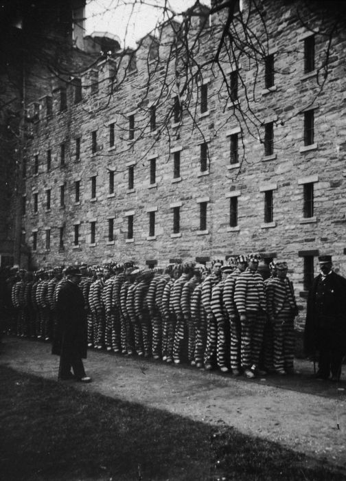 circa 1890: A group of prisoners are lined up at The Lock-step Penitentiary on Blackwell's Island (now Roosevelt Island) in New York City. (Photo by Jacob A. Riis/Museum of the City of New York/Getty Images)